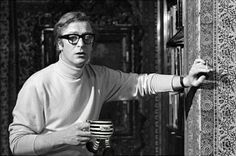 """Santino and Co Walking Pottery Studio Wares Michael Caine on the set of 'The Italian Job', holding The Prisoner """"ON THE RUN"""" Walking Cup. Michael once said, """"Take this Santino & Co Funny Cup fom me and I will blow your bloody doors off"""". A producer over-heard that and it was used in the movie! Check it out on Wikipedia: 20 Things You Probably Never Knew About 'The Italian Job'. Made by Santino Dipiazza. Not your average potter."""