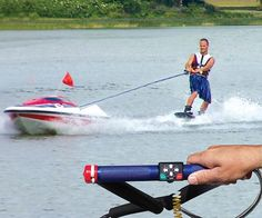 Water ski anywhere and be in complete control with this unmanned water skiing boat that is controlled entirely by the skier. This unmanned skier boat holds up to six gallons of gas and automatically shuts off if the skier lets go of the handle. I NEED THIS