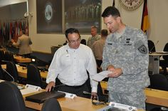 Our @Marshall_Center #team working @EUCOM Security Seminar July 20: Craig Coder, Event Coordinator with U.S. Army Maj. Cody Strong from EUCOM