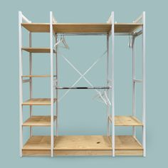 Combining our classic Lundia shelving with adjustable hanger rails to create a modular wardrobe solution. Decor, Wardrobe Solutions, Shelves, Bedroom Wardrobe, Shelving Unit, Home Decor, Cube Storage, Bedroom, Shelving