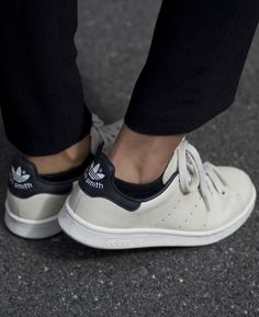 Funda is wearing chalk white Adidas Stan Smith trainers