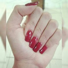 Biosculpture nails, in a sultry red.
