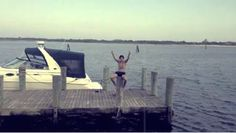 HARRY SITTING ON A DOCK I LOVE HIM SO MUCH