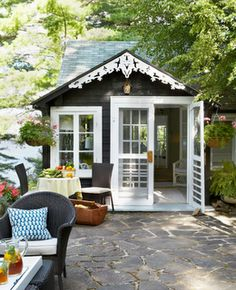 little house off the back patio or nestled in a well treed and shrub lot.