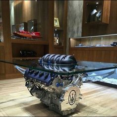 A grand coffee table made from a Maserati engine!