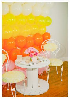 balloon backdrop and delicate dining table - photography by @Michelle March, furniture and place settings by unearthed vintage!
