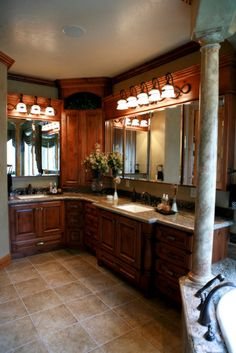 Master Bathroom with corner vanity.  I love this idea, except would leave the bottom of the vanity open for a chair or bench.