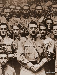 Look at their eyes.  Very disturbing.   Hitler and SA members (undated, probably 1935).