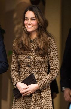 Kate recycled a pretty brown patterned coat dress by Orla Kiely.