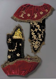 Pair of mitts Italian 18th century Object Place, Italy DIMENSIONS Overall: 32 x 27 x 2 cm (12 5/8 x 10 5/8 x 13/16 in.) ACCESSION NUMBER 38.1329a-b  Black velvet with crimson velvet turned back cuffs. The mitts and ruffles embroidered with gold thread in rococo floral pattern. Trimmed with gold bobbin lace. Black velvet and bobbin lace very much worn. Collection Achille Jubinal No. 75.