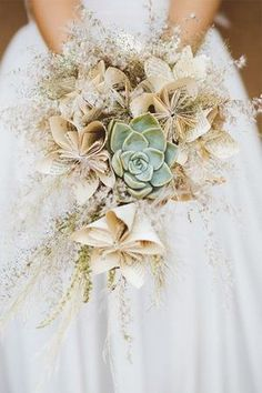 succulent plant wedding bouquets with paper decor for bohemian weddings