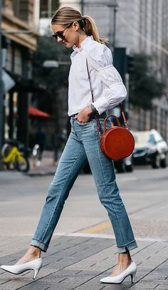 trendy spring outfit / white blouse + jeans + round bag + heels