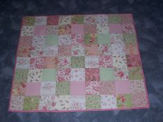 a friend asked me to make a little throw quilt for a friends baby girl.