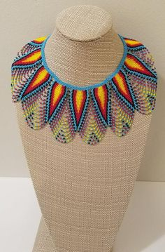 This wide necklace was handmade in a small community of Ecuador using Czech beads. It has light blue red and yellow color. Measurements: Length: 17 inches Width: 4 inches Find more colors and patterns here: African Beads, African Jewelry, African Accessories, Tribal Necklace, Collar Necklace, Collar Tribal, Wedding Jewellery Inspiration, Boho Headband, Beaded Jewelry Patterns