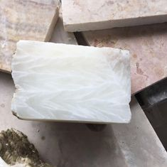 Cross cut section through a sample piece of onyx marble, we hand pick all our stone and with the onyx marble we're looking for translucency and whiteness. Onyx Marble, Stone, Food, Rock, Essen, Stones, Meals, Batu, Yemek