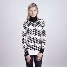 @Overstock - This women's houndstooth print turtleneck has a great look, fits great and is very stylish. This beautiful pullover features gold button shoulder details.http://www.overstock.com/Clothing-Shoes/Colour-Works-Womens-Houndstooth-Print-Turtleneck/7527320/product.html?CID=214117 $39.99