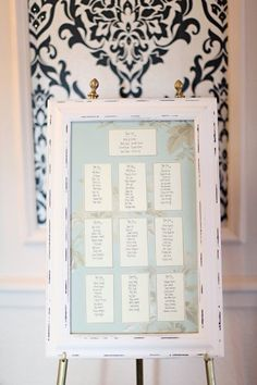 Pretty white frame for seating plan