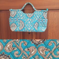 Vera Bradley | Totally Turq Gabby Pre-loved re-posh in EXCELLENT condition! It's seriously like new! I bought it on PM and never used it. Two wraparound exterior pockets. Zippered top. Three interior slip pockets. One interior zip pocket. Ask questions before purchasing. Trades, PayPal, modeling or holds Price firm at $15 Vera Bradley Bags