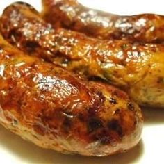 Bratwursts are simmered in a mixture of beer, onions, and seasonings, and then finished on the grill! #beeffoodrecipes