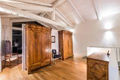 Casa di Campagna: Spogliatoio in stile translation missing: it.style.spogliatoio.coloniale di UAU un'architettura unica