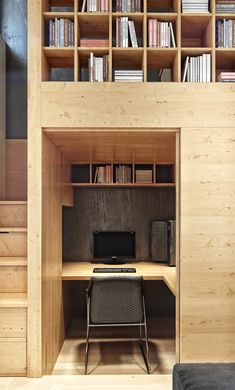 office concealed behind sliding mirror, built under stairs. creative use of small space!