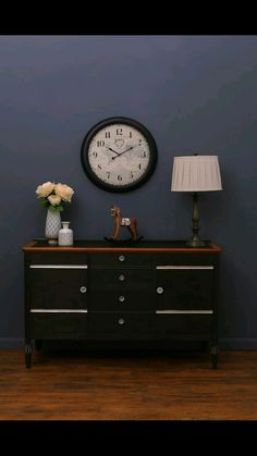 Vintage sideboard painted using Graphite Annie Sloan Chalk Paint with dark wax. Glass handles and silver leaf gilding by Love Restored.