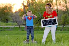 mom and her son in Superhero outfits on a spring evening in the field
