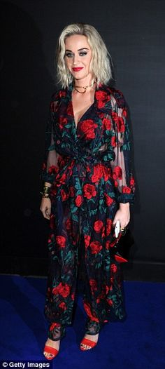 Blooming lovely! Katy Perry looked incredible in a black satin trouser suit adorned with radiant red roses which showed off her phenomenal figure