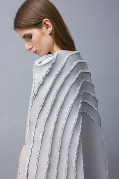 """Sewing replaced with soldering to create garments with """"scar lines""""."""