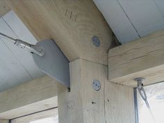 Contemporary oak frame fixings with bead-blasted stainless steel finish by Roderick James Architects