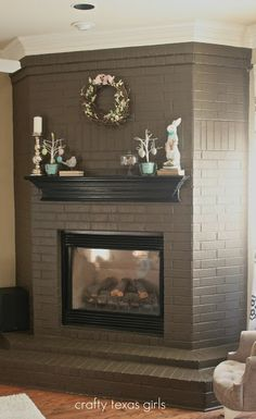 Chocolate painted brick to re-vamp an old fireplace