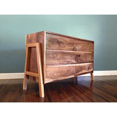 "The A Dresser: A 6 draw dresser made from sold walnut with white oak A frame legs. 58""x 36""x18"""