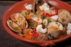 Our bike tours in the Alentejo region expose guests to delicious local cuisine like pork and clams Alentejana.  Pork and Clams Alentejana Recipe from Chop Onions, Boil Water - World Food at Home