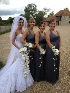 Bouquets always look best when carried by the bride. How stylish do the bridesmaids look with their wrist corsages.