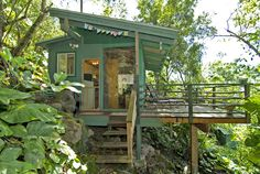 Set in a lush tropical paradise, the 250-square-foot Sunset Beach Treehouse Bungalow in Haleiwa, Hawaii.    - HouseBeautiful.com