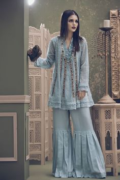 Ayesha Ibrahim is back at it again with her exquisitely made brand new collection- featuring chic cuts and silhouettes, pastel color schemes and delicate embellishments rendering the pieces in this… Pakistani Couture, Pakistani Dress Design, Pakistani Outfits, Indian Outfits, Terno Casual, Gharara Pants, Fashion Pants, Fashion Outfits, Sharara Designs