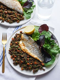 Pan-Fried Sea Bass with Chorizo and Lentils | Pan-seared sea bass fillets pair perfectly with puy lentils, spinach and chorizo. This is such a quick recipe to make its ideal for an easy weeknight dinner! | elizabethchloe.com | #seabass #chorizo #lentils #fishrecipes #seafoodrecipes #seafood #panfried #quickdinner #quickrecipes #easydinner #elizabethchloerecipes Shellfish Recipes, Seafood Recipes, Entree Recipes, Healthy Dinner Recipes, Fish Dishes, Main Dishes, Pan Fried Salmon, Healthiest Seafood, Quick Weeknight Meals
