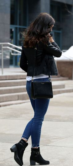 Faux leather moto jacket is a must any season! Paired with black booties, skinny raw hem jeans, and a black crossbody.