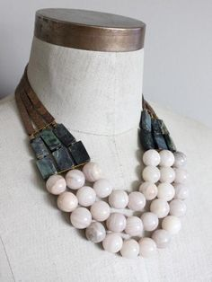 """17"""" 3-strand necklace with plated hematite, green serpentine, brass beads, and pink agate beads. 3 inch extender. David Aubrey / ODL117 / $118.00"""