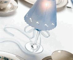 DIY wine glass candle lamps- using vellum to make shades.I always see wine glasses at thrift stores Diy Projects To Make And Sell, Easy Diy Projects, Candle Lamp, Glass Candle, Glass Lamps, Glass Lanterns, Tea Candles, Candleholders, Wine Glass Crafts