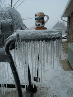2009 ice storm in Springdale Arkansas ice cycles hanging off the bbq grill. I put the cup just to be funny.