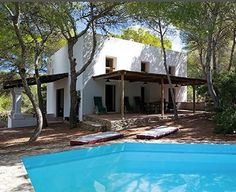 Formentera, Baleares, Spain. A modern villa immersed in the green of a pine forest