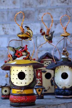 Cindy Lou Farley's Birdhouses, clay and glaze fired to cone 5, copper wire.