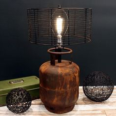 Shop for Rivet and Rust Metal Industrial Tank Lamp. Get free delivery at Overstock - Your Online Lamps & Lamp Shades Store! Get in rewards with Club O! Metal Industrial, Industrial Lighting, Industrial Vintage, Industrial Table, Industrial Furniture, Lampe Steampunk, Rusted Metal, Rustic Lamps, Rustic Table