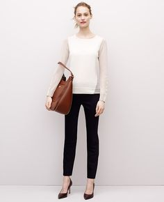 The Colorblocking is made to flatter, the hint of faux leather on the sleeves amps up the style. Merino Colorblock Sweater l Ann Taylor