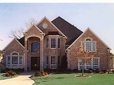 Eplans New American House Plan - Grand Brick Home - 3896 Square Feet and 4 Bedrooms from Eplans - House Plan Code HWEPL57137