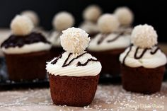 Chocolate Cupcakes with Coconut Frosting - Chocolate cupcakes flavored with Almond Joy coffee creamer and topped with silky smooth coconut frosting and a Raffaello Almond Coconut candy. Cupcake Flavors, Cupcake Recipes, Dessert Recipes, Köstliche Desserts, Delicious Desserts, Plated Desserts, Mini Cakes, Cupcake Cakes, Homemade Frosting Recipes