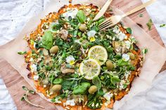 This super easy pizza crust is made only from sweet potato and it's topped with lovely greens and fresh herbs.