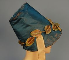 TWO POKE BONNETS, One teal satin with applied cloth leaves, vines and yellow flowers, moire ribbon ties, silk. on Apr 2012 Vintage Dresses, Vintage Outfits, Vintage Fashion, Vintage Hats, Vintage Clothing, Historical Costume, Historical Clothing, Edwardian Gowns, 19th Century Fashion