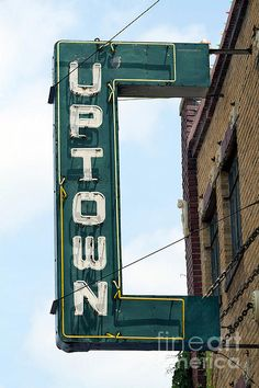 """The Uptown Theatre is an historic theater in Marceline, Missouri, which is Walt Disney's hometown. Disney saw his first movie in Marceline, one of the experiences that inspired his career dreams. Although, the Disney family had moved from Marceline by the time the Uptown Theatre opened, Disney returned to premiere """"The Great Locomotive Chase"""" in the Uptown."""
